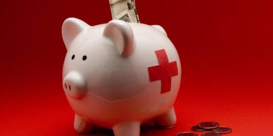 Piggybank with medical cross